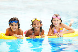 Happy diverse children in a pool