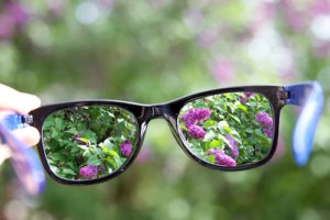 eyeglasses in the hand over blurred background